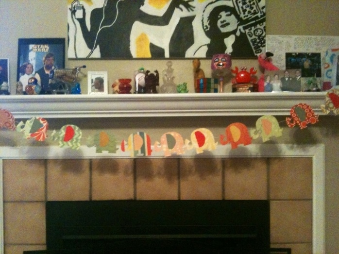 A finished elephant parade garland on my mantle