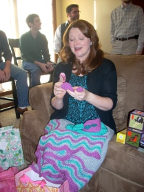 Admiring the baby gifts